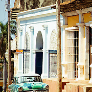 An old vintage car parked on the street in the historic colonial town of Trinidad, Cuba.