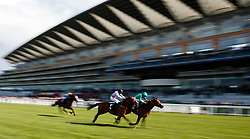Century Dream (right) ridden by Steve Donohoe comes home to win The Celebrating The Commonwealth Paradise Stakes (Listed) from Crazy Horse, (centre) ridden by Jim Crowley at Ascot Races.