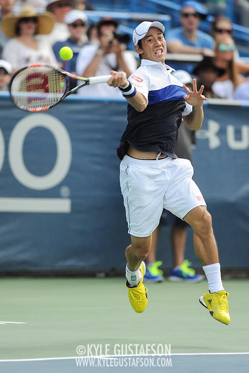 KEI NISHIKORI of Japan plays against John Isner of the United States during the men's final of the Citi Open at the Rock Creek Tennis Center in Washington, D.C. Nishikori won in 3 sets.