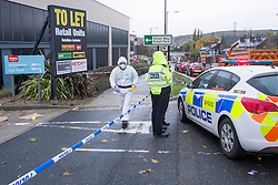 Police Block the Argos goods entrance from the Halifax Rd crime scene, stretching from Kilner way to Southey Green Rd. Locals information say the crime was a stabbing.<br /> <br /> 29 October 2015<br />  Image © Paul David Drabble <br />  www.pauldaviddrabble.co.uk