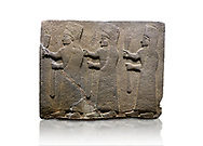 Hittite monumental relief sculpted orthostat stone panel of a Procession. Basalt, Karkamıs, (Kargamıs), Carchemish (Karkemish), 900-700 B.C.  Marching female figures. Anatolian Civilisations Museum, Ankara, Turkey.<br /> <br /> It is a depiction of three marching female figures in long dress with a high headdress at their head. These women are considered to be the nuns of the Goddess Kubaba. They have a bunch of Spica in their right hand, and objects similar to a sceptre in their left hand. <br /> <br /> Against a white background. .<br />  <br /> If you prefer to buy from our ALAMY STOCK LIBRARY page at https://www.alamy.com/portfolio/paul-williams-funkystock/hittite-art-antiquities.html  - Type  Karkamıs in LOWER SEARCH WITHIN GALLERY box. Refine search by adding background colour, place, museum etc<br /> <br /> Visit our HITTITE PHOTO COLLECTIONS for more photos to download or buy as wall art prints https://funkystock.photoshelter.com/gallery-collection/The-Hittites-Art-Artefacts-Antiquities-Historic-Sites-Pictures-Images-of/C0000NUBSMhSc3Oo