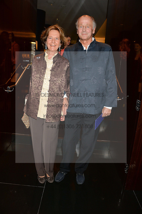SIMON & CAROLYN PARKER BOWLES at the Launch Of Alain Ducasse's Rivea Restaurant At The Bulgari Hotel, 171 Knightsbridge, London on 8th May 2014.