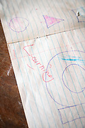 Close-up of textbook with drawings and writing, The Musoto Christian School, Uganda
