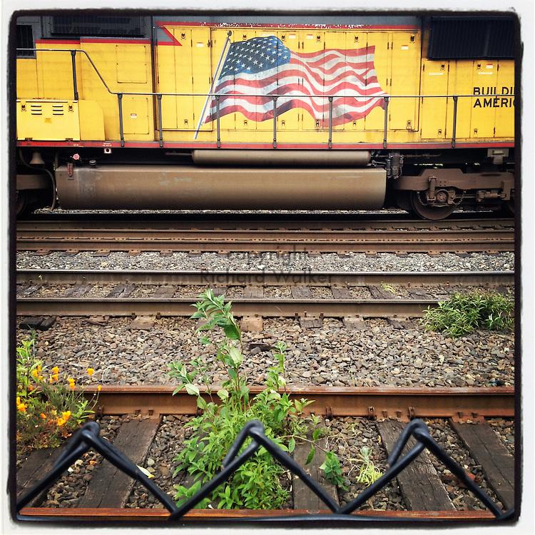2012 MAY 23 - Burlington Northern Santa Fe, BNSF, train locomotive on tracks in Georgetown, Seattle, WA, USA. Taken with Apple iPhone using Instagram App. By Richard Walker