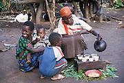 Africa, Ethiopia, Omo region, Ari village woman making tea