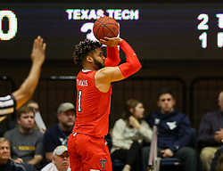 Feb 26, 2018; Morgantown, WV, USA; Texas Tech Red Raiders guard Brandone Francis (1) shoots a three pointer during the second half against the West Virginia Mountaineers at WVU Coliseum. Mandatory Credit: Ben Queen-USA TODAY Sports