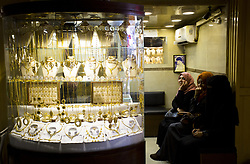 August 27, 2017 - Gaza City, The Gaza Strip, Palestine - A gold vendor in the ancient market in the Kisiriya district of Gaza City puts a piece of jewelry up for sale on August 27, 2017. (Credit Image: © Mahmoud Issa/Quds Net News via ZUMA Wire)