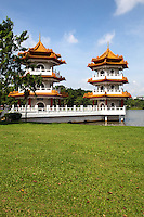 Twin Pagodas, Singapore Chinese - also known as Jurong Gardens, was made  in 1975 and designed by Prof. Yuen-chen Yu, an architect from Taiwan,. The garden's concept is based on the integration of architectural features within the natural environment. The garden is modeled along the northern Chinese imperial styles of landscaping.  In Chinese gardens, bridges play a critical role and the most important structures may denote a specific character.