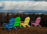 Rainbow colored chairs over looking Lake Winnipesaukee.   Chair colors manipulated with a little PS.  Karen Bobotas Photographer