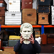 A man holds a theatrical prop in a warehouse facility owned by the English National Opera in London, Britain, 11 October 2017.  English National Opera (ENO) is an opera company based in London. It is one of the two principal opera companies in London. English National Opera traces its roots back to 1931 when Lilian Baylis established the Sadler's Wells Opera Company at the newly re-opened the Sadler's Wells Theatre. Baylis had been presenting opera concerts and theatre in London since 1898 and was passionate about providing audiences with the best theatre and opera at affordable prices. ENO became the first British opera company to tour the United States, and the first major foreign opera company to tour what was then the Soviet Union.EPA-EFE/NEIL HALL