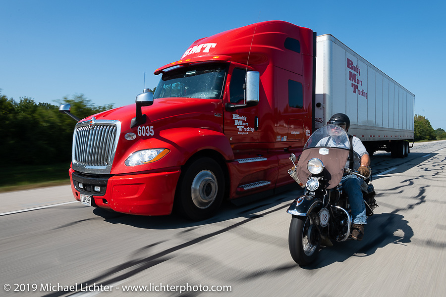 Willie Earhart passing a semi on his 1948 Harley-Davidson Panhead in the Cross Country Chase motorcycle endurance run from Sault Sainte Marie, MI to Key West, FL (for vintage bikes from 1930-1948). Stage 4 saw a 315 mile ride from Urbana, IL to Bowling Green, KY USA. Monday, September 9, 2019. Photography ©2019 Michael Lichter.