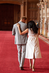 The Duke and Duchess of Sussex with their baby son (Name later announced as Archie Harrison Mountbatten-Windsor), who was born on Monday morning, during a photocall in St George's Hall at Windsor Castle in Berkshire.