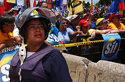 The Metropolitan Police patrol as members of the opposition to President Chavez celebrate the midpoint in his term, as it marks the first day that the process to hold a recall referendum can take place.  More than three million signatures requesting that recall referendum were delivered to the National Electoral Council in the early morning.  Tens of thousands of people marched in celebration.