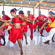 CAPTION: Members of Troupe Dahomey practice a dance routine. Partnering with IAF is allowing SPA and Troupe Dahomey to scale their interventions through this dance school, as well as technical and administrative assistance. Soon, a new music studio will open as well. ORGANIZATION: Troupe Dahomey / Sant Pont Ayiti (SPA). LOCATION: La Fleur du Chaine, Rue Capois, Port-au-Prince, Haiti. INDIVIDUAL(S) PHOTOGRAPHED: From left to right: Tamara Belabe, Sanon Reginald, Louis Oldin, Phanor Joanne, David Dunosier, Noël Annot Louis, Bertine Role and Marc-Elise Pierre.