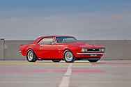 """1967 Chevrolet Camaro - Custom vermillion red .454ci (7.4L) big block V8, 3-spd auto (TH350), LSD 3.5:1, 31-spline billet axles, custom tailshaft, Centerline Autodrag 15x7"""" & 15x8.5"""" Wheels, 2"""" cowl hood, metal trunk spoiler, RS taillights & indicators .Docklands, Port Melbourne, Victoria.20th December 2009 .(C) Joel Strickland Photographics.Use information: This image is intended for Editorial use only (e.g. news or commentary, print or electronic). Any commercial or promotional use requires additional clearance."""