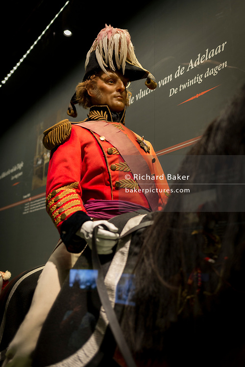 The Prince of Orange sits on his horse, a waxwork exhibit inside the Memorial 1815 exhibition at the Waterloo battlefield, on 25th March 2017, at Waterloo, Belgium. Inaugurated on the battle's bicentenary, visitors experience the history of Napoleonic Europe and the armies of both the French and allied armies on that day. The Battle of Waterloo was fought 18 June 1815. A French army under Napoleon Bonaparte was defeated by two of the armies of the Seventh Coalition: an Anglo-led Allied army under the command of the Duke of Wellington, and a Prussian army under the command of Gebhard Leberecht von Blücher, resulting in 41,000 casualties.