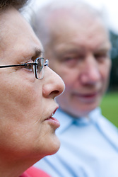 Older couple sitting together talking,