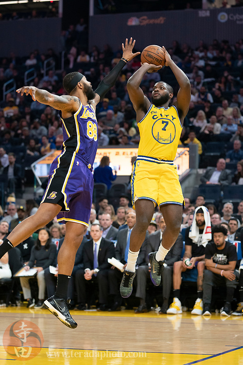 February 27, 2020; San Francisco, California, USA; Golden State Warriors forward Eric Paschall (7) shoots the basketball against Los Angeles Lakers forward Markieff Morris (88) during the third quarter at Chase Center.