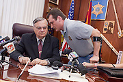 """19 JUNE 2009 -- PHOENIX, AZ: Deputy Doug Matteson (CQ) RIGHT) talks to Sheriff Joe Arpaio before the sheriff's press conference Friday. The Sheriff's Department is headquartered in the Wells Fargo Bank building. Rev. Al Sharpton was in Phoenix Friday to protest the high profile """"crime suppression"""" sweeps conducted by the Sheriff's Department. Critics contend the sweeps use racial profiling to target Hispanics. PHOTO BY JACK KURTZ"""