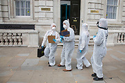 Extinction Rebellion 'crime scene investigators' in white suits and masks put up climate crime scene tape to investigate areas of ecocide in a performance outside the Cabinet Office on 7th September 2020 in London, United Kingdom. The 20 investigators were protesting at the UK government's ecocide along the HS2 route. Extinction Rebellion is a climate change group started in 2018 and has gained a huge following of people committed to peaceful protests. These protests are highlighting that the government is not doing enough to avoid catastrophic climate change and to demand the government take radical action to save the planet.