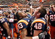 Syracuse's Shamarko Thomas, 43, and Carl Cutler, 48, celebrate their victory over Rutgers University, 31-13, at Syracuse University in Syracuse, N.Y., Saturday, Nov. 21, 2009..(AP Photo/Heather Ainsworth)