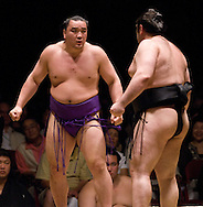 Ama (left)) stares at Kokkai before their match in the third round of Day 1 of Grand Sumo Tournament Los Angeles 2008, Los Angeles Sports Arena, Los Angeles, California