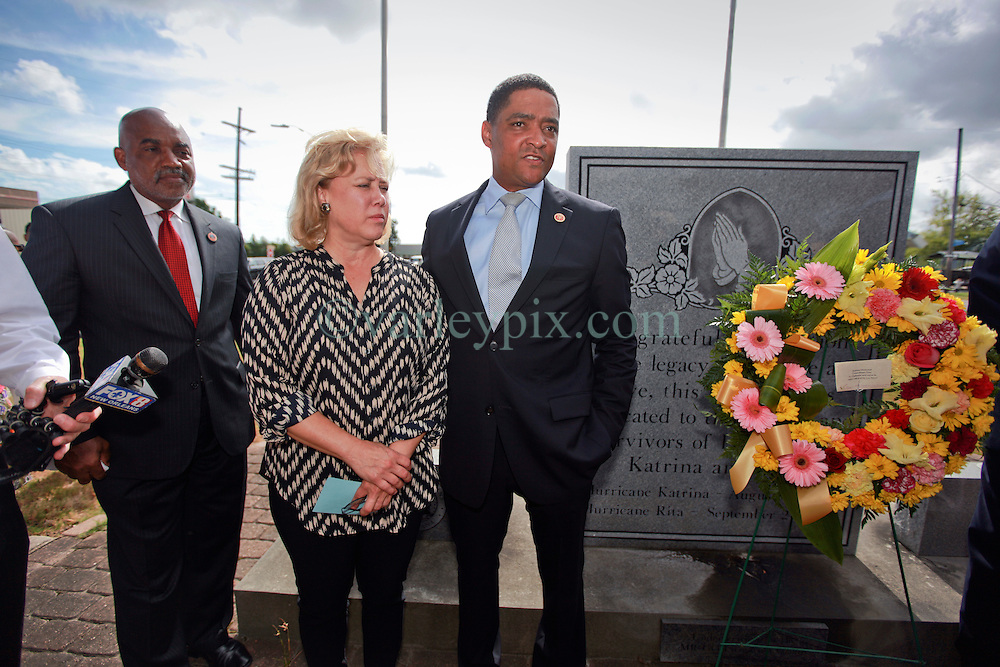 29 August 2014. Lower 9th Ward, New Orleans, Louisiana. <br /> Laying the commemorative wreath. L/R; Councilman James Gray, Senator Mary Landrieu and Congressman Cedric Richmond join local dignitaries and hurricane Katrina survivors at the official memorial in remembrance of the day Hurricane Katrina swamped the community 9 years ago today..<br /> Photo; Charlie Varley/varleypix.com