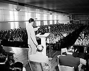"Y-500830-01.  ""Evangelist Billy Graham tells over 1400 inmates of Oregon State Penitentiary that 'Jesus Christ can change your life right here from hell to paradise' if they accept Jesus Christ. Some 40-50 hands went up when he asked an indication of faith."" August. 30, 1950."