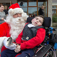 Cormac McMahon from Lissycasey meets Santa at St Clares School