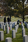 ARLINGTON, VA - NOVEMBER 11: U.S. President Barack Obama and first lady Michelle walk through Arlington National Cemetery after greeting family members of fallen service men and women on Veteran's Day November 11, 2012 in Arlington, Virginia. Numerous events are under across the country to honor the nation's current and former service members.