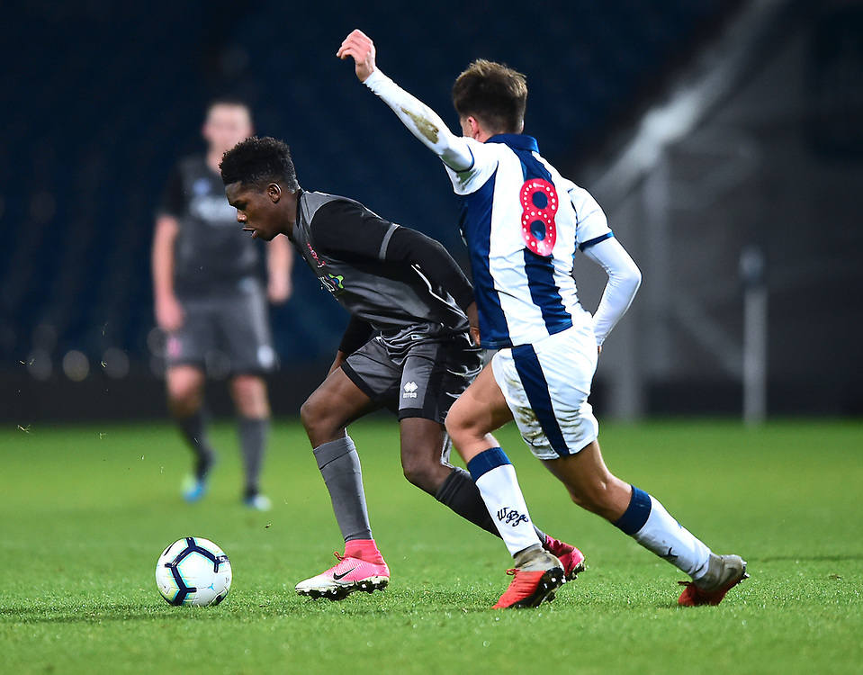 Lincoln City U18's Timothy Akinola gets past West Bromwich Albion U18's Zak Brown<br /> <br /> Photographer Andrew Vaughan/CameraSport<br /> <br /> FA Youth Cup Round Three - West Bromwich Albion U18 v Lincoln City U18 - Tuesday 11th December 2018 - The Hawthorns - West Bromwich<br />  <br /> World Copyright © 2018 CameraSport. All rights reserved. 43 Linden Ave. Countesthorpe. Leicester. England. LE8 5PG - Tel: +44 (0) 116 277 4147 - admin@camerasport.com - www.camerasport.com