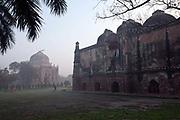 A man exercises between the Bara Gumbad and the Sheesh Gumbad, Lodhi Gardens, New Delhi, India,