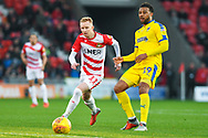 Ali Crawford of Doncaster Rovers (11) tries to get round Tom Soares of AFC Wimbledon (19) during the EFL Sky Bet League 1 match between Doncaster Rovers and AFC Wimbledon at the Keepmoat Stadium, Doncaster, England on 17 November 2018.