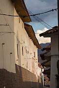Ancient Incan brickwork siding a alleyway leading to the Plaza de Armas, Cusco, Peru, South America