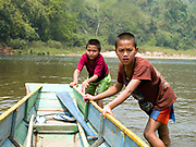 "Two boys, Sone (13) and Sengpheth (10) push a boat to the edge of the Nam Ou river, Phongsaly province, Lao PDR. The Nam Ou river connects small riverside villages, but this river and others like it, that are the lifeline of rural communities and local economies are being blocked, diverted and decimated by dams. The Lao government hopes to transform the country into ""the battery of Southeast Asia"" by exporting the power to Thailand and Vietnam."