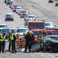 State Police, McKinley County Police, and McKinley County Fire and Rescue work together to stabilize an injured driver at the scene of a two car collision in the north bound lane of 491 near Chee Dodge Elementary in Yah-Ta-Hey Thursday. The driver was air lifted from the scene by a helicopter for transportation to Albuquerque.