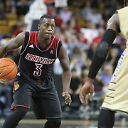 Louisville Cardinals guard Chris Jones (3) dribbles during an NCAA basketball game between the 14th ranked Louisville Cardinals and the UCF Knights at the CFE Arena on Tuesday, December 31, 2013 in Orlando, Florida. (AP Photo/Alex Menendez)