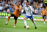 Molineux Wolverhampton Wanderers v Sheffield Wednesday  16/08/2008 Championship<br /> Michael Kightly (Wolves)<br /> Tommy Spurr (Sheffield Wednesday)<br /> Photo Roger Parker  Fotosports Interntional