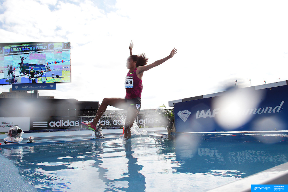 Sofia Assefa, Ethiopia, in action at the water jump on her way to winning the Women's 3000m Steeplechase during the Diamond League Adidas Grand Prix at Icahn Stadium, Randall's Island, Manhattan, New York, USA. 14th June 2014. Photo Tim Clayton