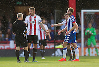 Brentford's Harlee Dean is shown a yellow card by Referee Andy Woolmer<br /> <br /> Photographer Ashley Western/CameraSport<br /> <br /> The EFL Sky Bet ChampionshipBrentford v Wigan Athletic - Saturday 1st October 2016 - Griffin Park - London<br /> <br /> World Copyright © 2016 CameraSport. All rights reserved. 43 Linden Ave. Countesthorpe. Leicester. England. LE8 5PG - Tel: +44 (0) 116 277 4147 - admin@camerasport.com - www.camerasport.com