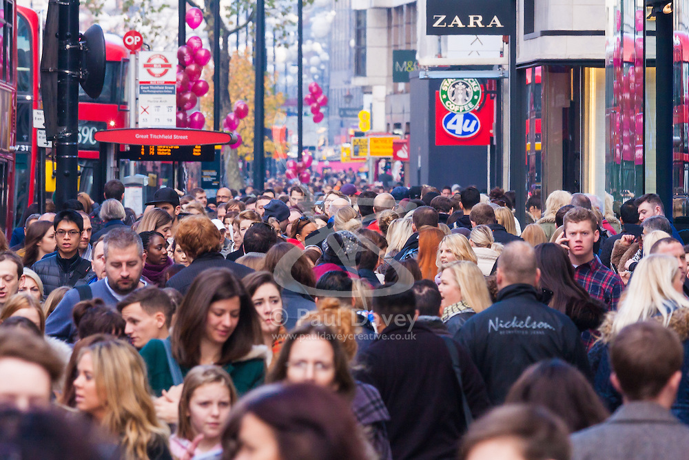 th 2014. Tens of thousands of shoppers flood central London as  Black Friday discounts and most people's pay days kick off the Christmas shopping season in earnest. PICTURED: Tightly packed pavements on Oxford Street ensure no one gets anywhere fast.