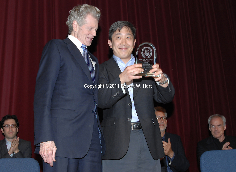 Christopher Shih receives a hug from Van Cliburn after winning the Sixth International Piano Competition for Outstanding Amateurs on Sunday May 29, 2011 in Fort Worth, Texas. The competition was held at Ed Landreth Auditorium on the TCU campus. Special Contributor/Robert W. Hart