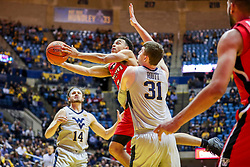 Dec 1, 2018; Morgantown, WV, USA; ,Youngstown State Penguins guard Darius Quisenberry (3) shoots in the lane while defended by West Virginia Mountaineers forward Logan Routt (31) during the first half at WVU Coliseum. Mandatory Credit: Ben Queen-USA TODAY Sports