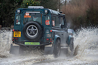 @Licensed to London News Pictures . 15/01/2015. Kent motorists driving through a flooded road. The River Medway between Yalding and Maidstone, including Wateringbury, West Farleigh, Teston and East Farleigh has received a flood warning following heavy rains last night and forecast again tonight (15/01/14). Photo credit: Manu Palomeque/LNP