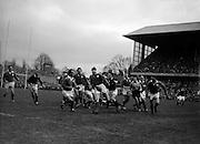 W J McBride, Irish forward, kicking to touch after line out. He got in his kick despite effort of R Stephen, Scottish forward,..Irish Rugby Football Union, Ireland v Scotland, Five Nations, Landsdowne Road, Dublin, Ireland, Saturday 24th February, 1962,.24.2.1962, 2.24.1962,..Referee- N M Parkes, Rugby Football Union, ..Score- Ireland 6 - 20 Scotland, ..Irish Team, ..F G Gilpin, Wearing number 15 Irish jersey, Full Back, Queens University Rugby Football Club, Belfast, Northern Ireland,..W R Hunter, Wearing number 14 Irish jersey, Right Wing, C I Y M S Rugby Football Club, Belfast, Northern Ireland, ..M K Flynn, Wearing number 13 Irish jersey, Right Centre, Wanderers Rugby Football Club, Dublin, Ireland, ..D Hewitt, Wearing number 12 Irish jersey, Left centre, Instonians Rugby Football Club, Belfast, Northern Ireland,..N H Brophy, Wearing number 11 Irish jersey, Left wing, Blackrock College Rugby Football Club, Dublin, Ireland, ..G G Hardy, Wearing  Number 10 Irish jersey, Stand Off, Bective Rangers Rugby Football Club, Dublin, Ireland,  ..J T M Quirke, Wearing number 9 Irish jersey, Scrum Centre, Blackrock College Rugby Football Club, Dublin, Ireland, ..S Millar, Wearing number 1 Irish jersey, Forward, Ballymena Rugby Football Club, Antrim, Northern Ireland,..A R Dawson, Wearing number 2 Irish jersey, Forward, Wanderers Rugby Football Club, Dublin, Ireland, ..R J McLoughlin, Wearing number 3 Irish jersey, Forward, University College Dublin Rugby Football Club, Dublin, Ireland, ..W A Mulcahy, Wearing number 4 Irish jersey, Captain of the Irish team, Forward, Bohemians Rugby Football Club, Limerick, Ireland,..W J McBride, Wearing number 5 Irish jersey, Forward, Ballymena Rugby Football Club, Antrim, Northern Ireland,..D Scott, Wearing number 6 Irish jersey, Forward, Malone Rugby Football Club, Belfast, Northern Ireland, ..M L Hipwell, Wearing number 8 Irish jersey, Forward, Terenure Rugby Football Club, Dublin, Ireland, ..M G Culliton, Wearing number 7 Irish jersey, F