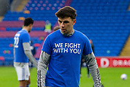 """Cardiff City's Mark Harris (29) during the pre-match warm-up before the EFL Sky Bet Championship match between Cardiff City and Millwall at the Cardiff City Stadium, Cardiff, Wales on 30 January 2021. Players wore """"We Fight With You"""" shirts during the warm up in support of Sol Bamba."""