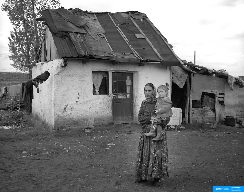 A Roma mother and her child in a gypsy community in Copsa Mica, Transylvania, Romania. 23rd July 2011. Photo Tim Clayton