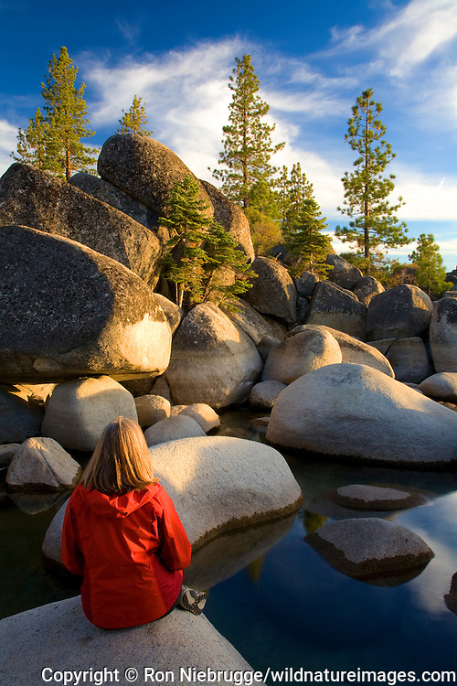 A visitor enjoys the rocky shoreline at Sand Harbor State Park, Lake Tahoe, Nevada.  (Model Released)