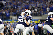 Penn State Nittany Lions quarterback Sean Clifford (14) throws a pass against the Memphis Tigers during the game of the NCAA Cotton Bowl Classic football game, Saturday, Dec. 28, 2019 at AT&T Stadium in Arlington, Texas. Penn State defeated Memphis 53-39. (Mario Terrana/Image of Sport)