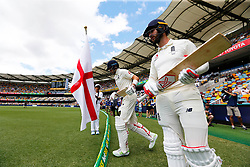 England's Joe Root and Mark Stoneman take the field during day four of the Ashes Test match at The Gabba, Brisbane.